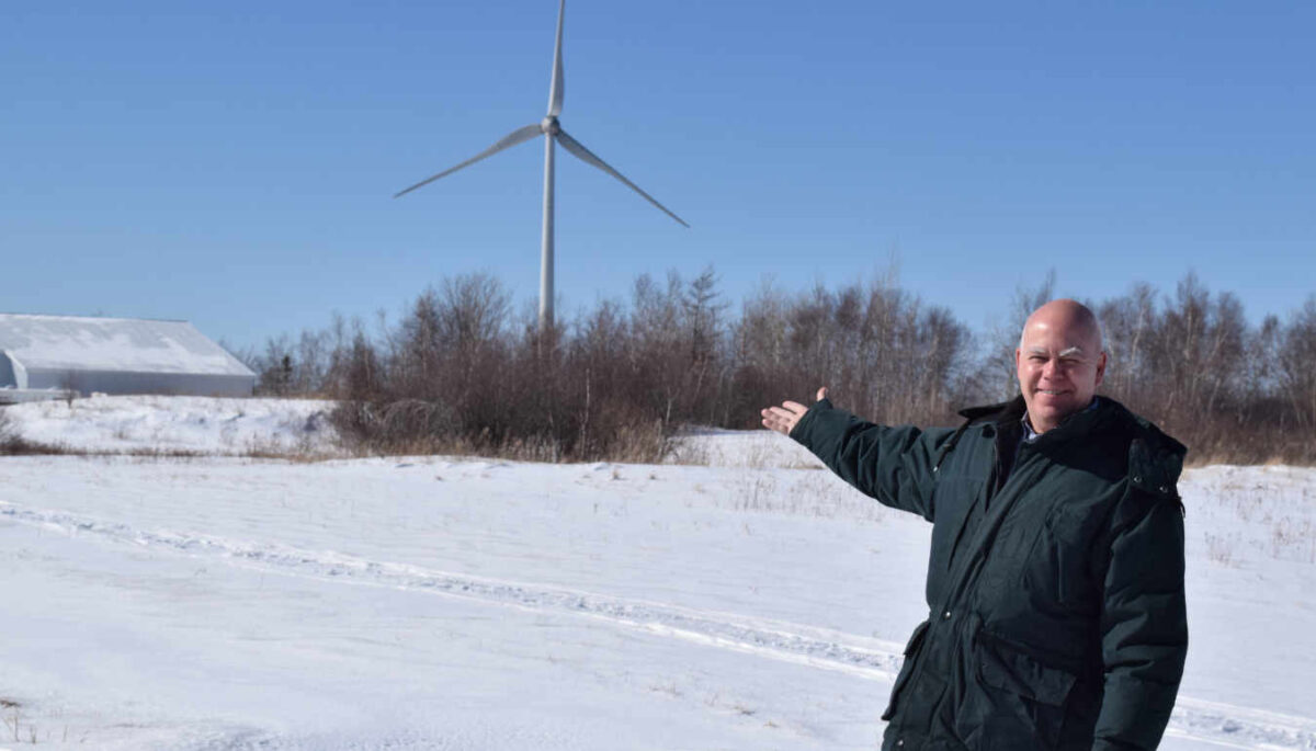 David Coon with wind turbine